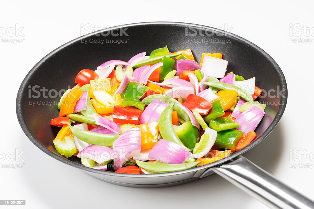 Colorful mixed vegetables in a frying pan stock photo