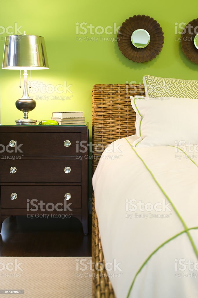 Colorful modern bed and side table in new home. royalty-free stock photo