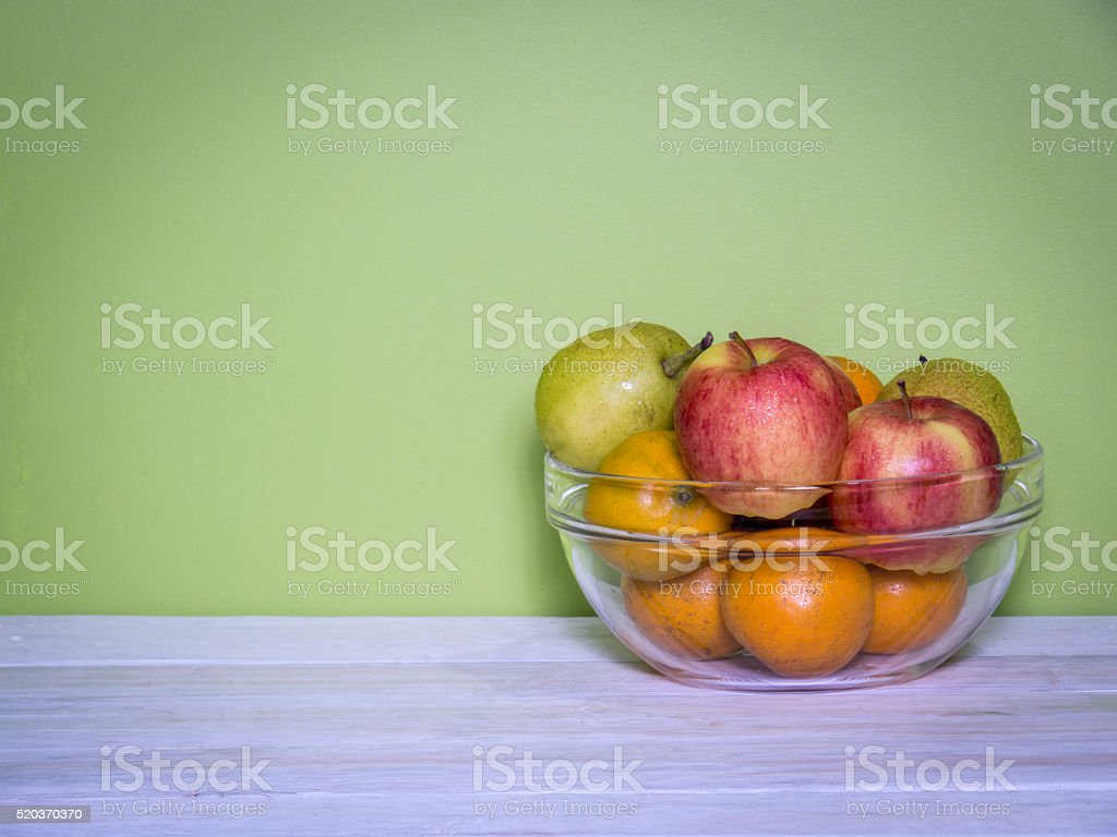 Colorful modern kitchen with fruits in glass bowl on table stock photo