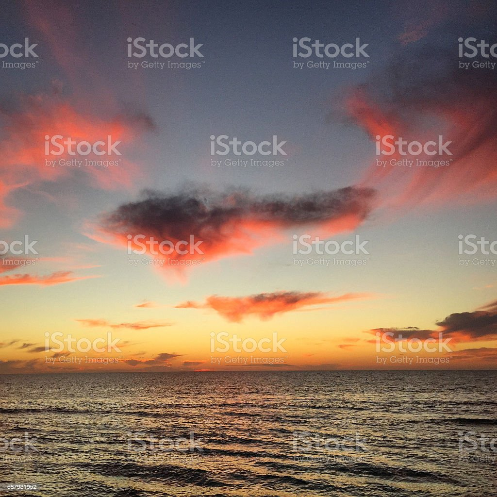 Colorful, Moody Sunset Over Water - Mobile Stock stock photo