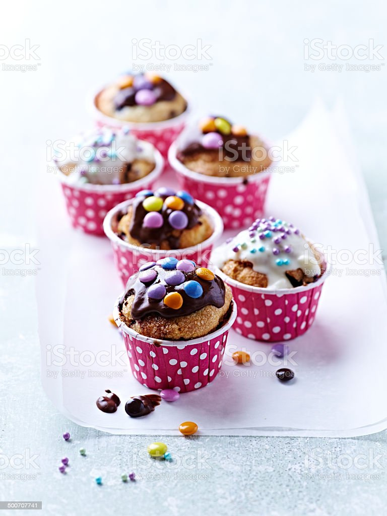Colorful Muffins with Dark and White Chocolate Glaze stock photo