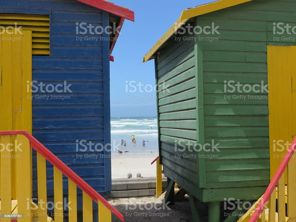Colorful Muizenberg South Africa beach huts and sea stock photo