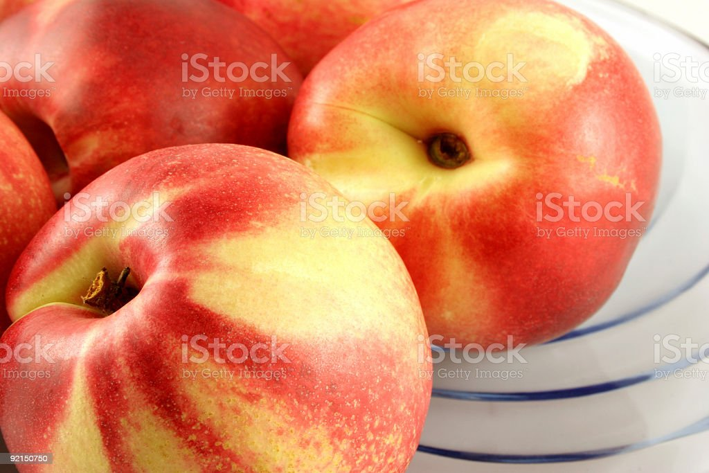 Colorful Nectarines in a Bowl stock photo