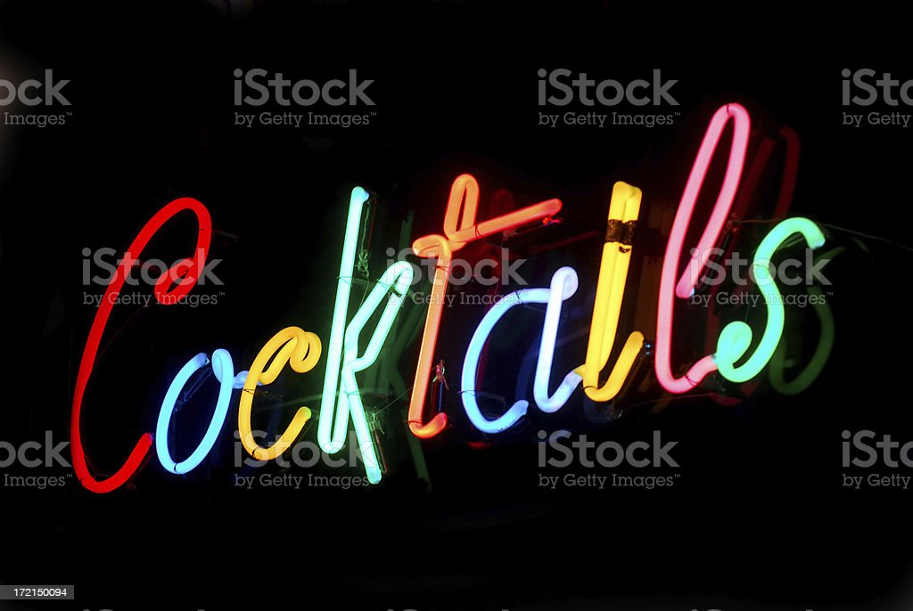 Colorful neon sign spelling Cocktails  stock photo