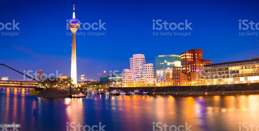 Colorful night scene of Rhein river at night in Dusseldorf stock photo