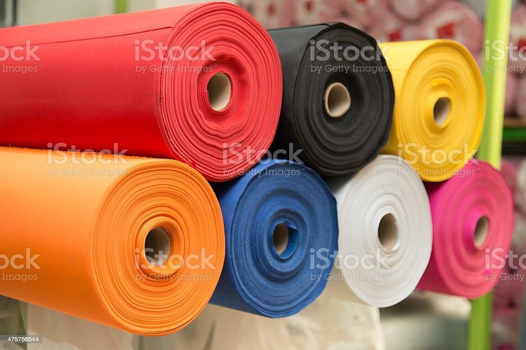 Colorful non-woven fabric rolls - material fabric stock photo