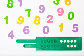 Colorful numbers and counting tool. Background.Closeup