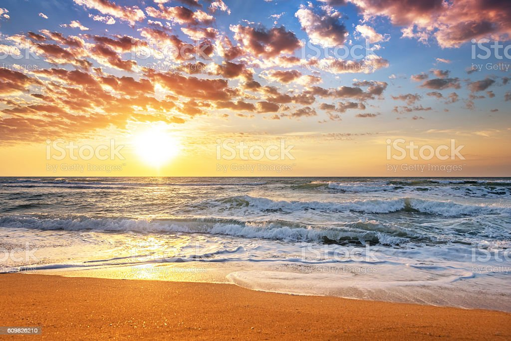 Colorful ocean beach sunrise. stock photo