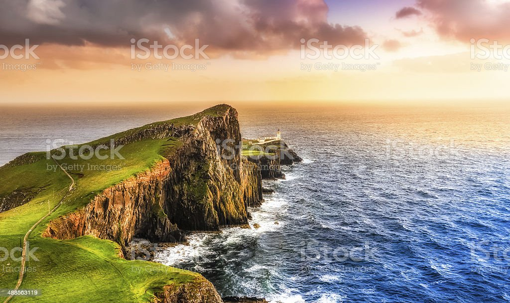 Colorful ocean coast sunset at Neist point lighthouse, Scotland stock photo