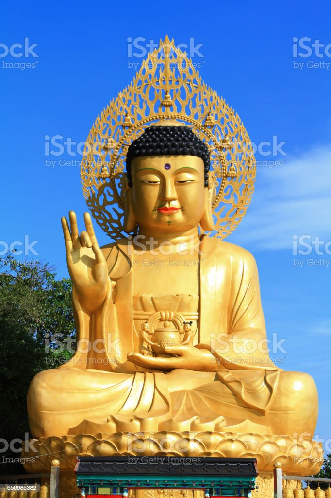 Colorful of Gold Giant Buddha Statue at Sanbanggulsa Temple, Jeju Island in South Korea stock photo
