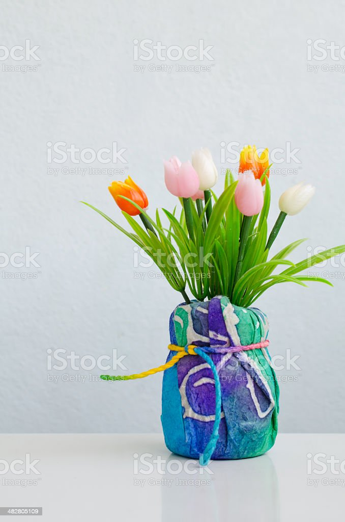 Colorful of Plastic flower in pot, tulip stock photo
