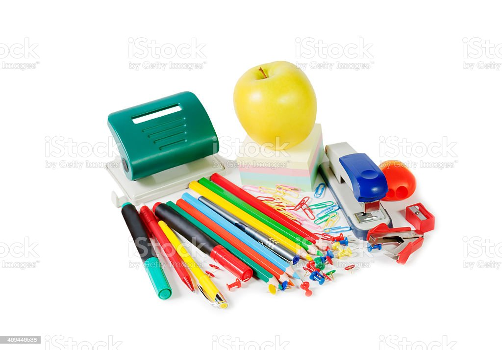 Colorful office supplies and green  apple isolated on white background stock photo