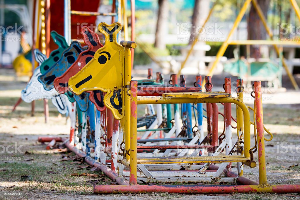 Colorful old  and rusty iron rocking horse stock photo