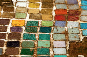Colorful  Old Mosiac Tiles on Sandy Outdoor Garden Path