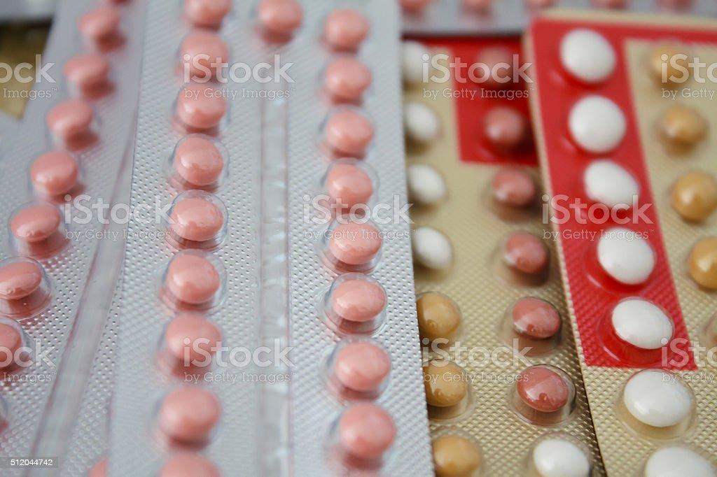 Colorful oral contraceptive pill stock photo