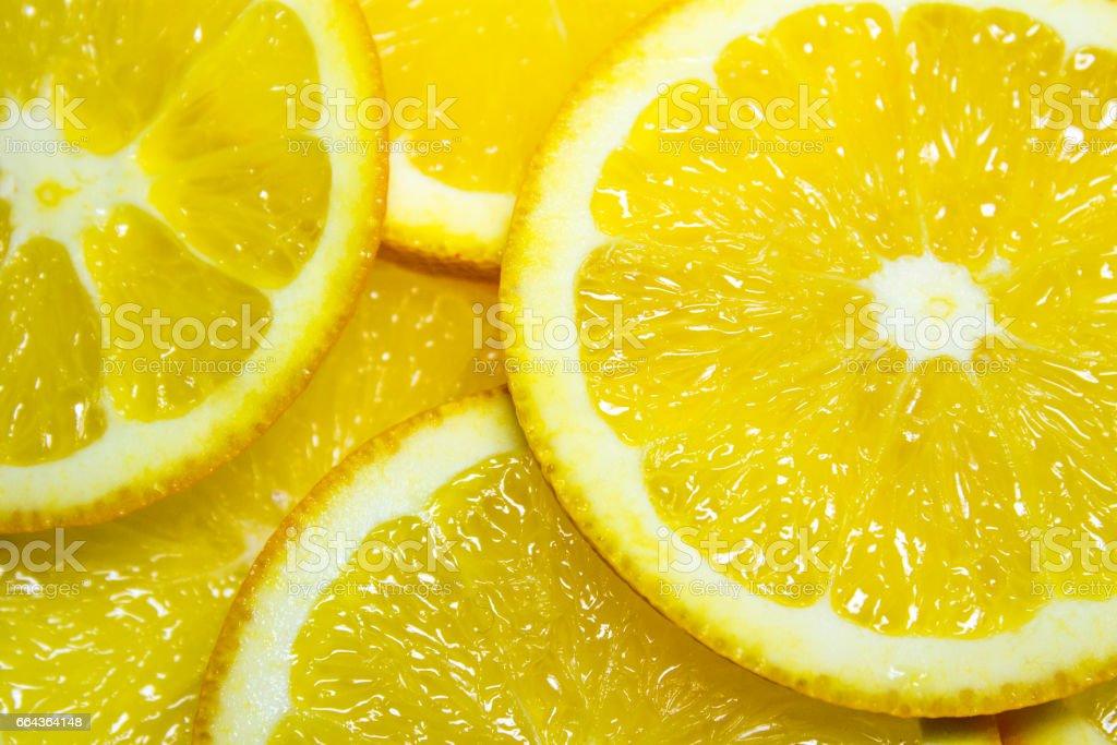 Colorful orange citrus fruit slices background stock photo