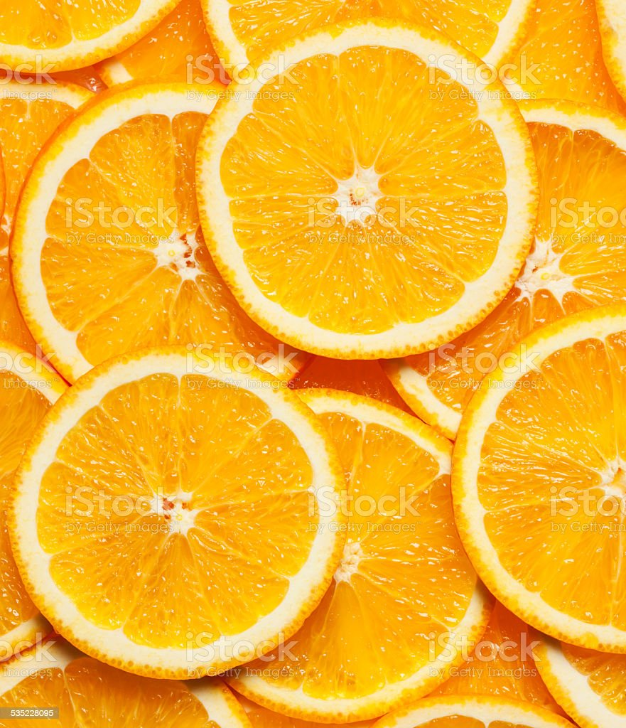 Colorful orange fruit slices stock photo