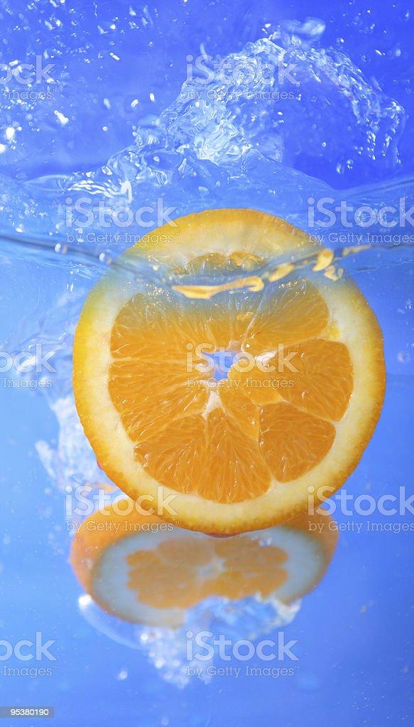 colorful orange slice on a fresh background stock photo