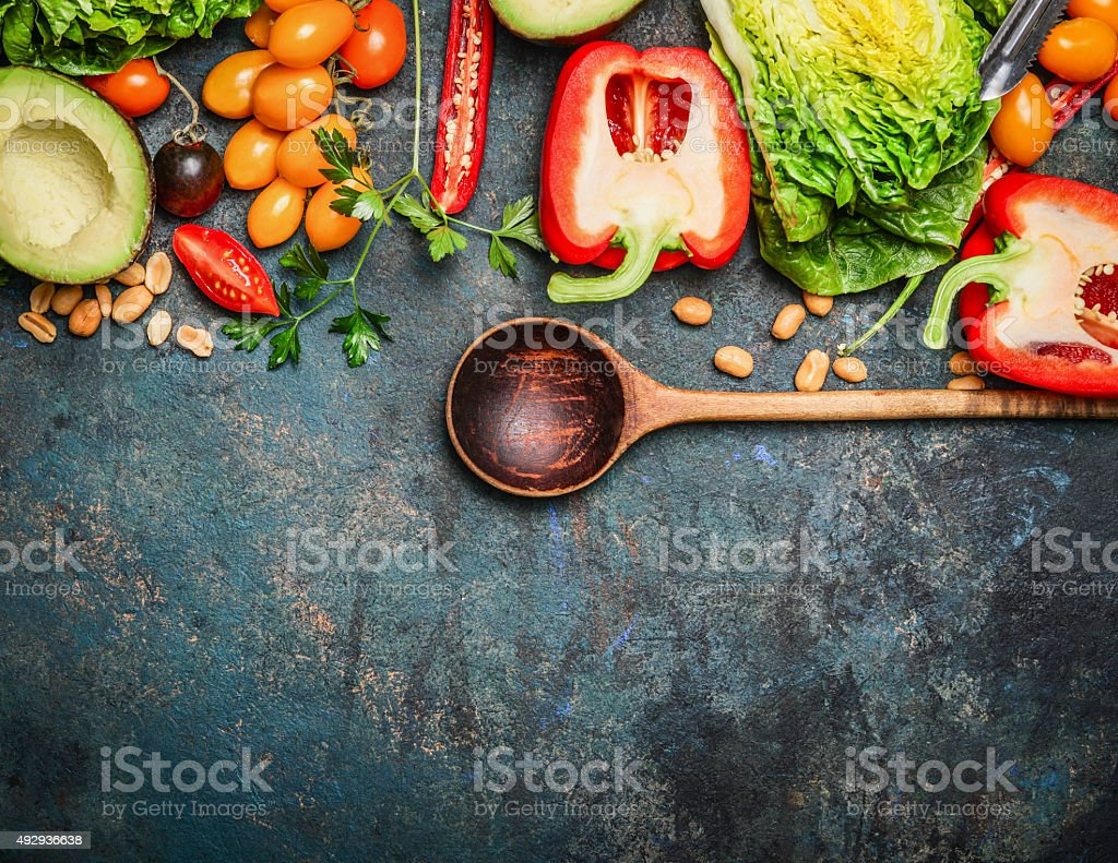 Colorful organic vegetables with wooden spoon , ingredients stock photo