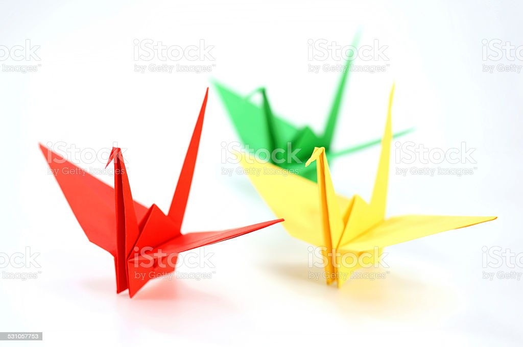 colorful Origami cranes on white background stock photo