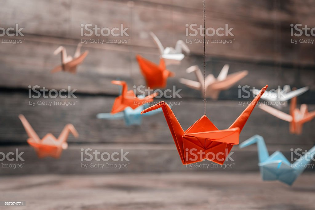 Colorful origami paper cranes stock photo