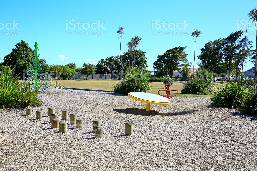 Colorful Outdoor children playground on a sunny day, New Zealand stock photo