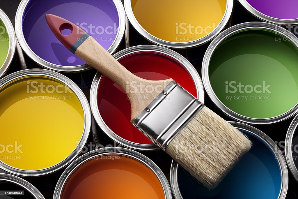 Colorful paint cans with brush stock photo