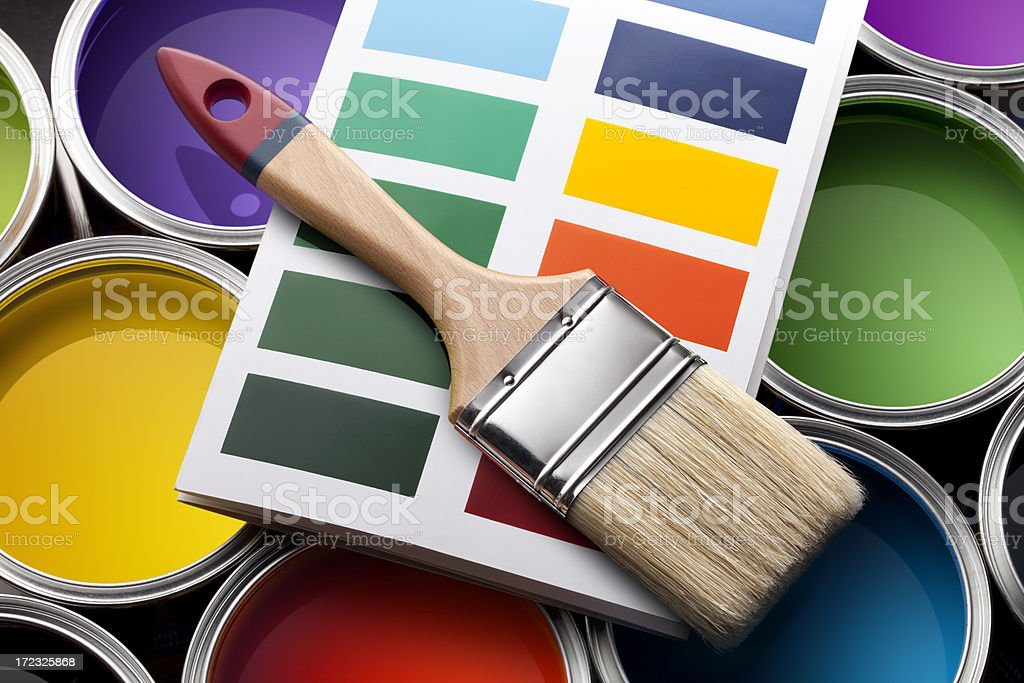 Colorful paint cans with color card and brush royalty-free stock photo