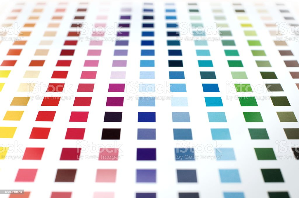 Colorful paint swatches in squares on a white background stock photo