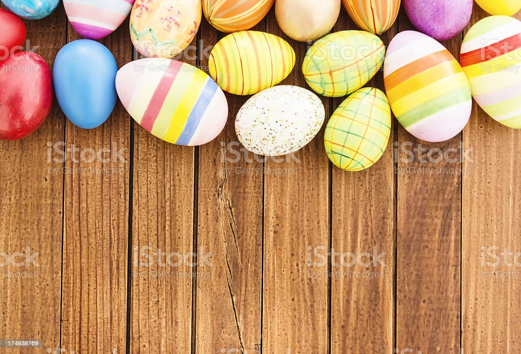 Colorful painted easter egg background on wood royalty-free stock photo