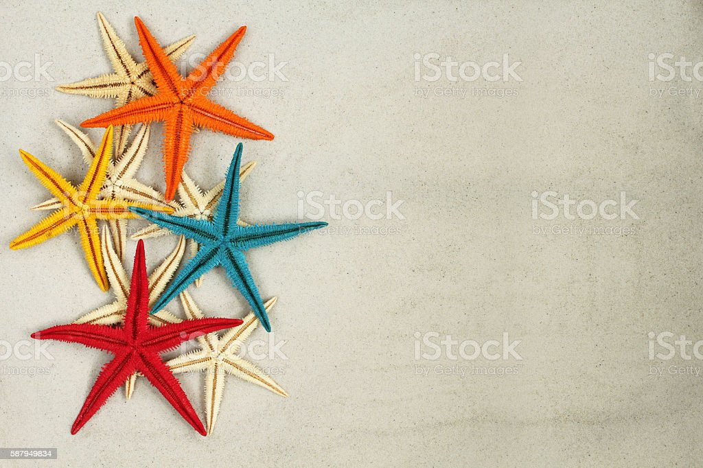 Colorful painted Starfishes on the sand stock photo