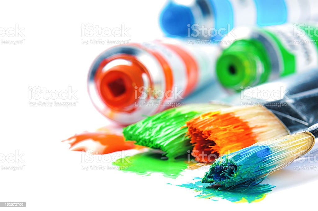 Colorful paints and artist brushes royalty-free stock photo