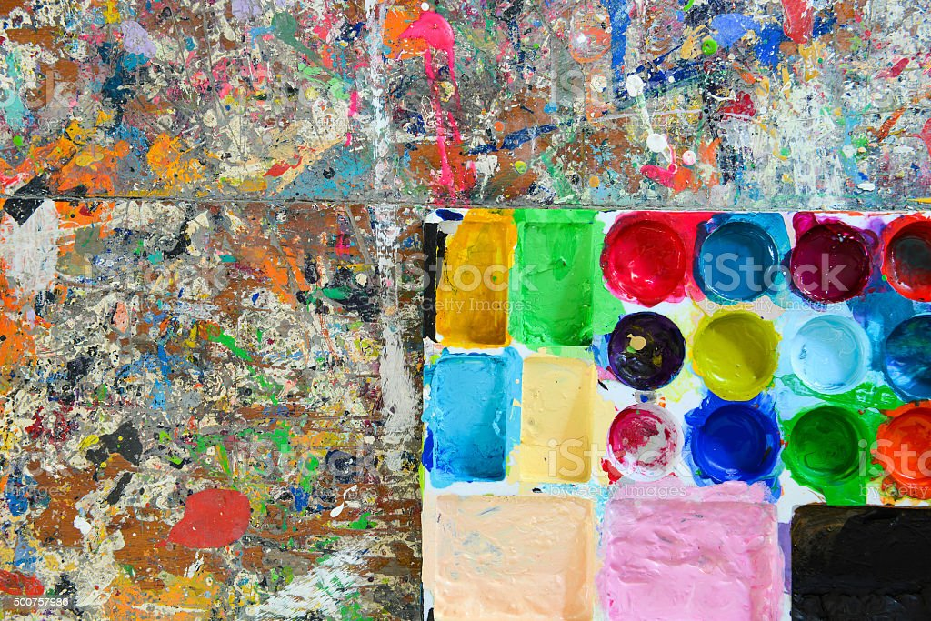 Colorful palette and Splash acrylic color on wood table. stock photo