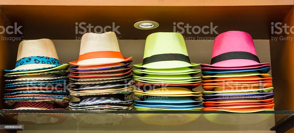 XXXL: Colorful Panama hats displayed on a shelf stock photo