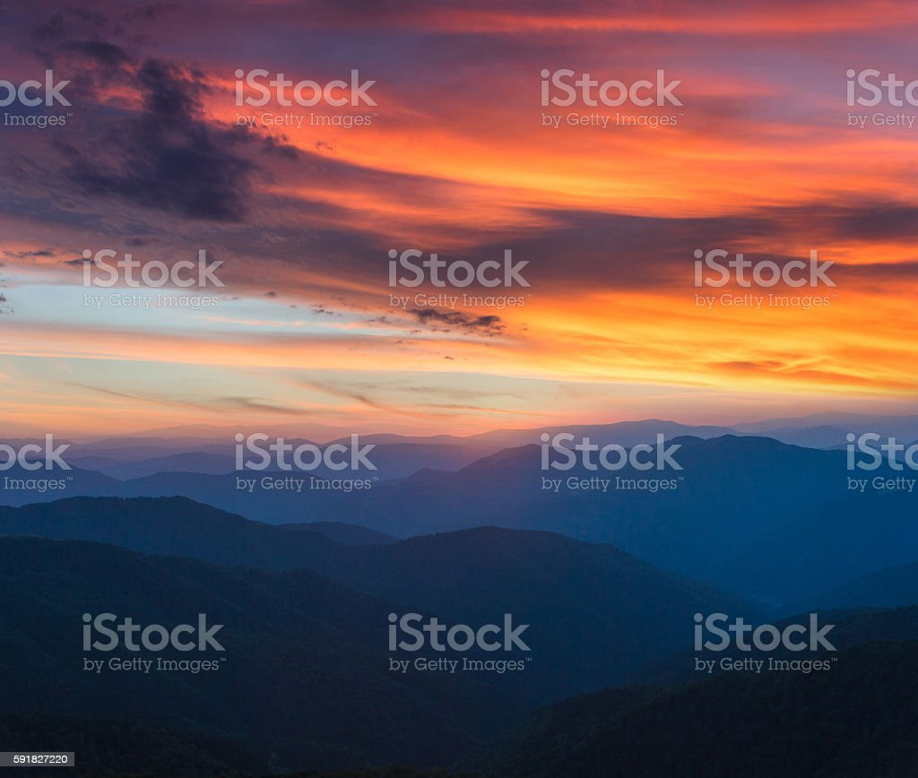 Colorful panoramic sunrise in the mountains. stock photo
