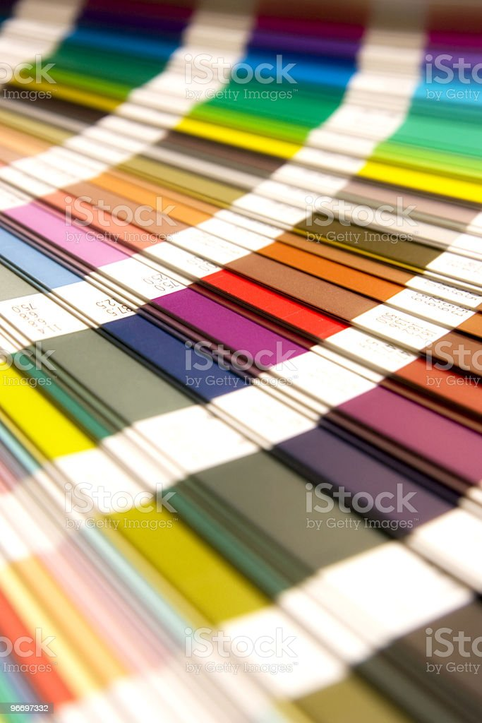 Colorful Pantone chips fanned out showing many colors stock photo