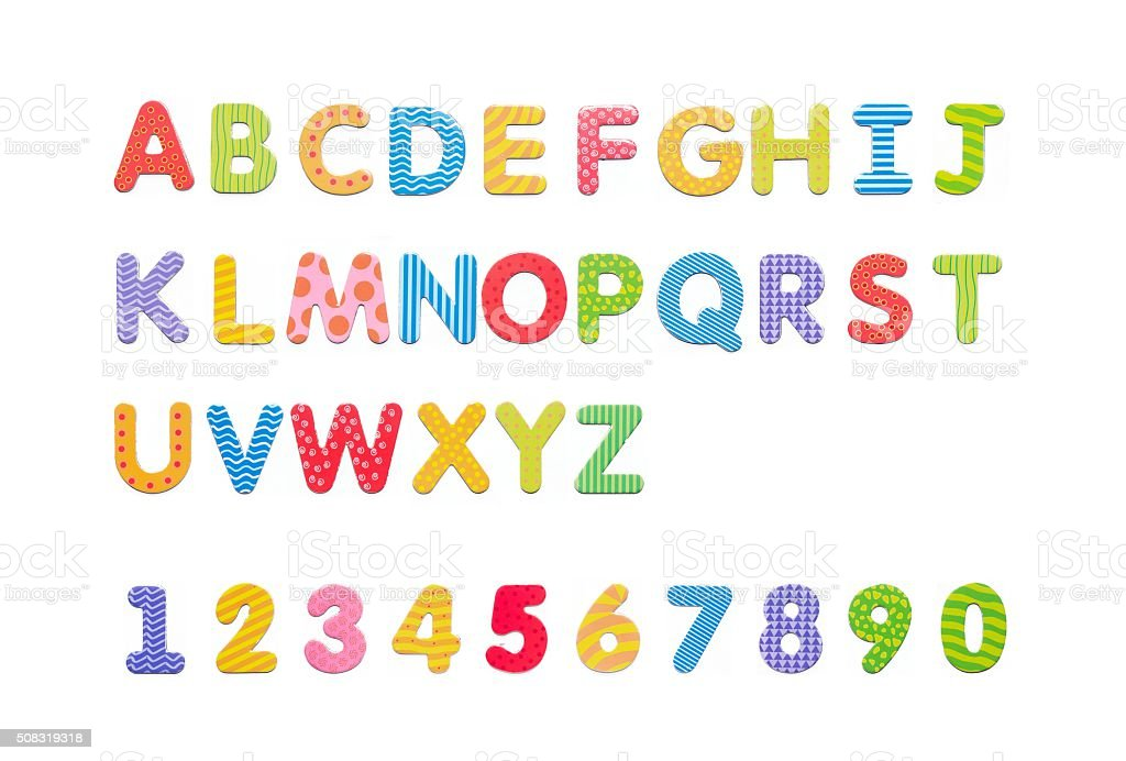 Colorful paper alphabet magnets on a whiteboard. Letters set iso stock photo