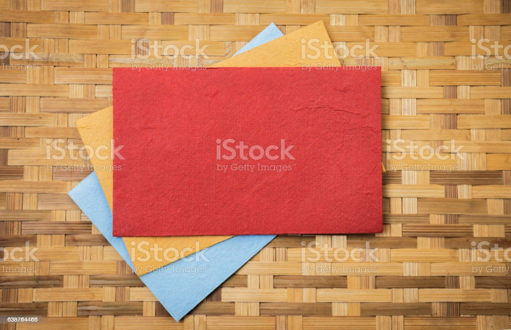 Colorful paper card on bamboo texture background stock photo
