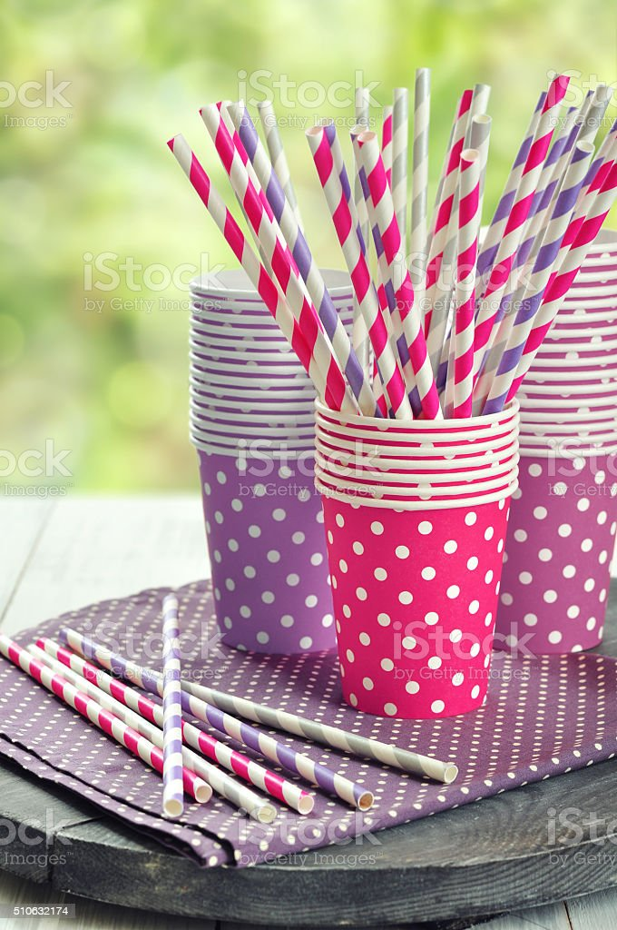 Colorful paper cups and striped straws stock photo