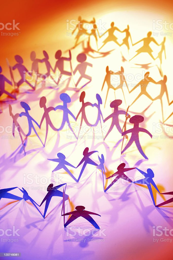 Colorful paper cutouts of a crowd over an orange background stock photo