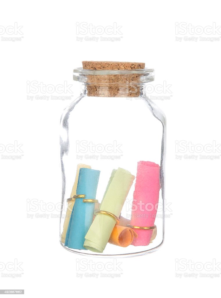 colorful paper in the bottle with cork isolated on white stock photo