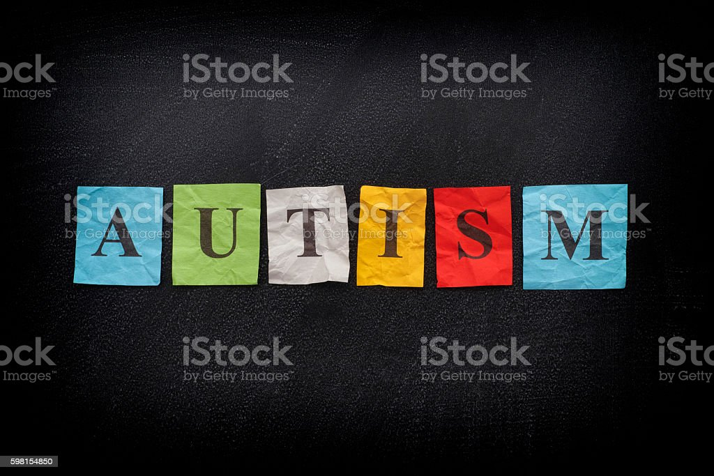 Colorful paper notes with word the Autism stock photo