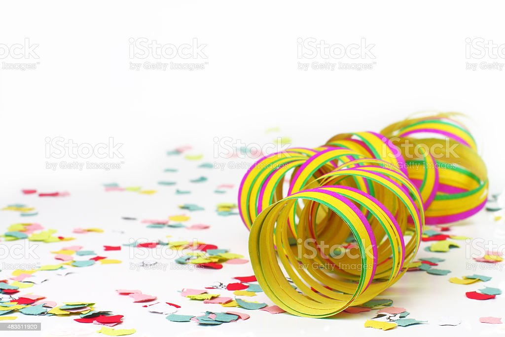Colorful paper streamers and confetti stock photo