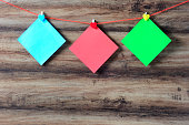 Colorful paper with clothespin hanging on a string