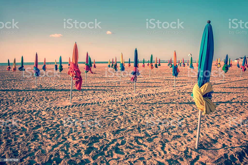Colorful parasols on Deauville beach, France, vintage process stock photo