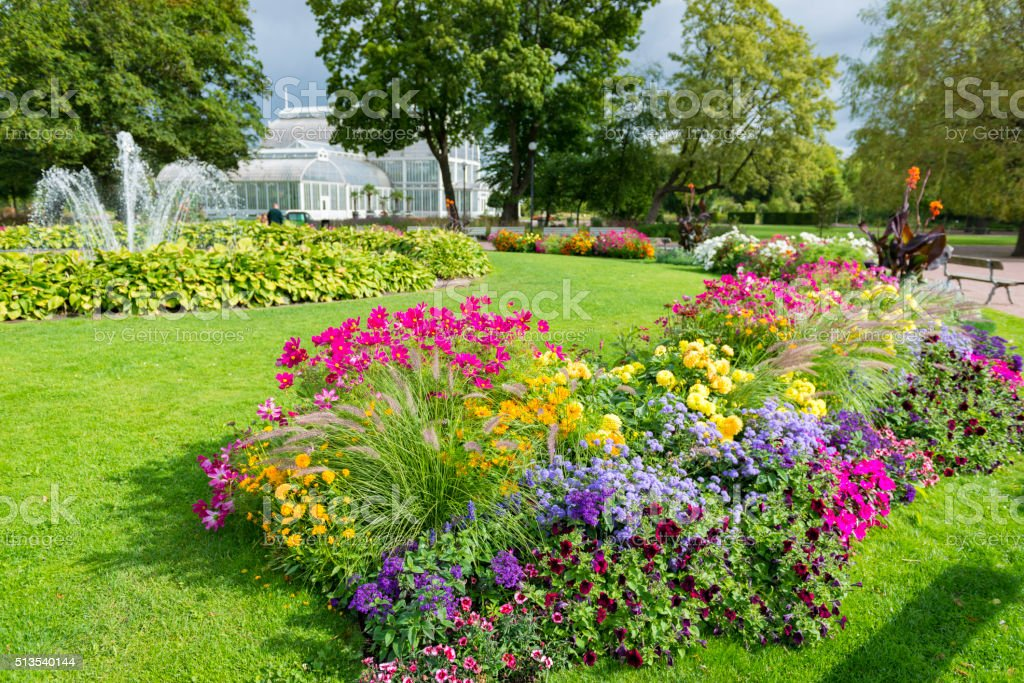 Colorful park with beautiful flowers and a fountain stock photo