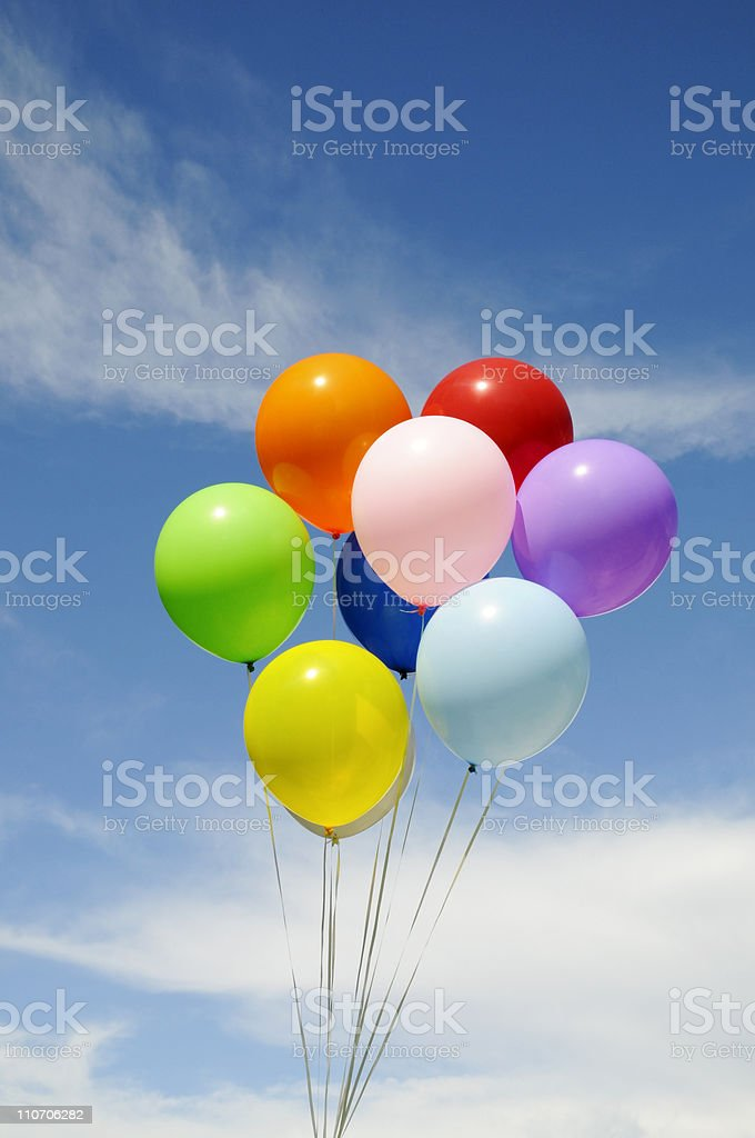 Colorful Party Balloons Bunched Against a Blue Sky royalty-free stock photo