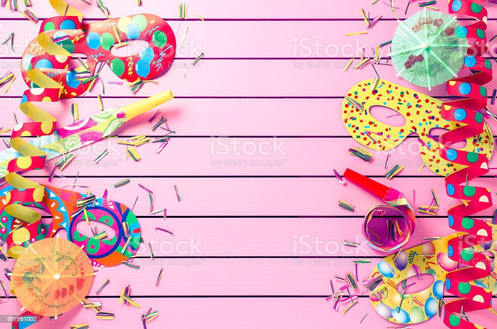Colorful party decoration on pink background stock photo