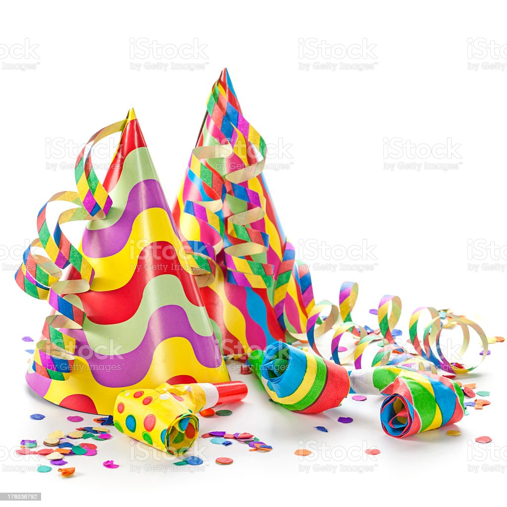 Colorful party hats, confetti and horn isolated in white stock photo