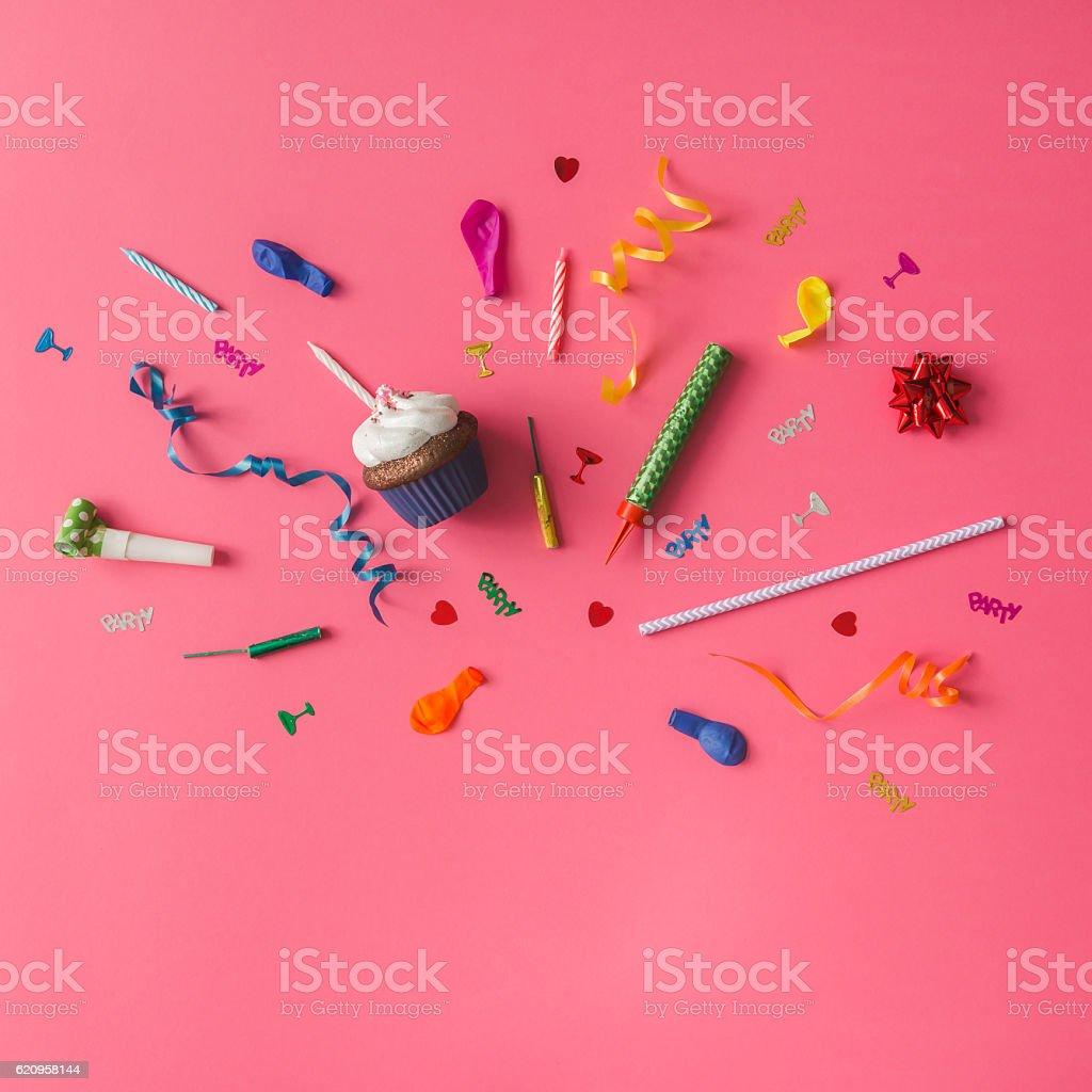 Colorful party items on pink background. Flat lay. stock photo